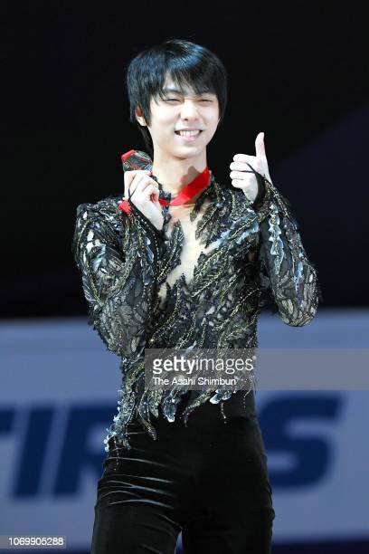 Gold medalist Yuzuru Hanyu of Japan celebrates on the podium at the medal ceremony for the Men's Singles on day three of the ISU Grand Prix of Figure...