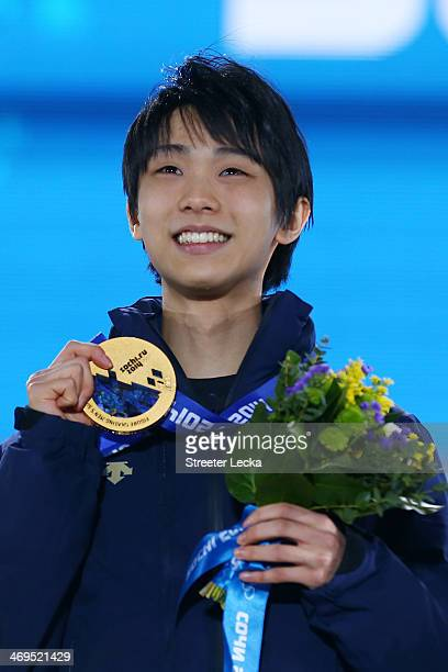 Gold medalist Yuzuru Hanyu of Japan celebrates on the podium during the medal ceremony for the Men's Figure Skating on day 8 of the Sochi 2014 Winter...