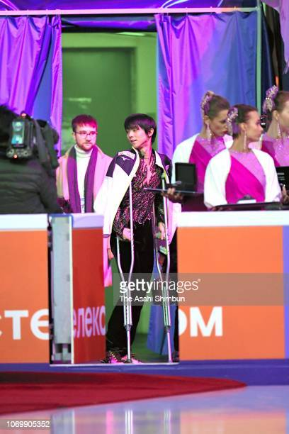 Gold medalist Yuzuru Hanyu of Japan on crutches is seen prior to the medal ceremony for the Men's Singles on day three of the ISU Grand Prix of...