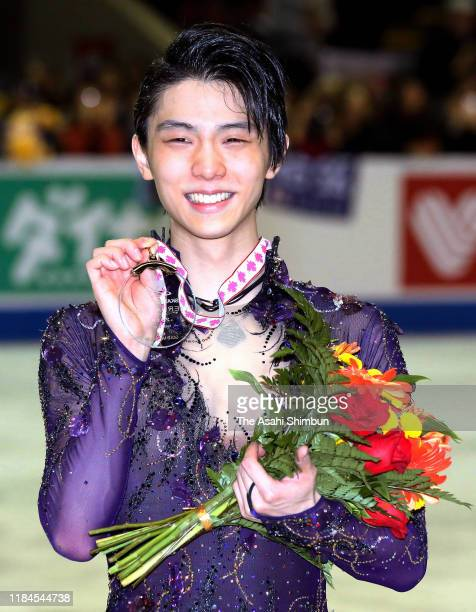 Gold medalist Yuzuru Hanyu of Japan poses for photographs at the medal ceremony in the Men's Singles during the ISU Grand Prix of Figure Skating...