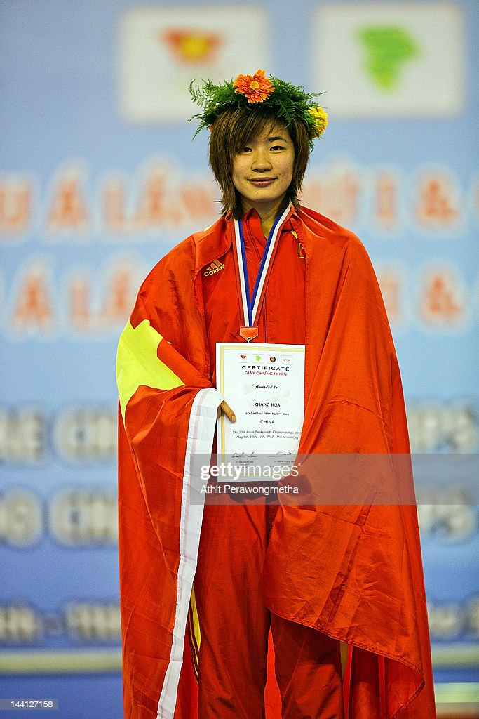 Gold Medalist Zhang Hua of China poses on a podium during day two of the 20th Asian Taekwondo Championships at Phu Tho Stadium on May 10, 2012 in Ho Chi Minh City, Vietnam.
