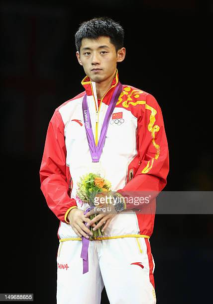 Gold medalist Zhang Jike of China poses on the podium during the medal ceremony for the Men's Singles Table Tennis on Day 6 of the London 2012...