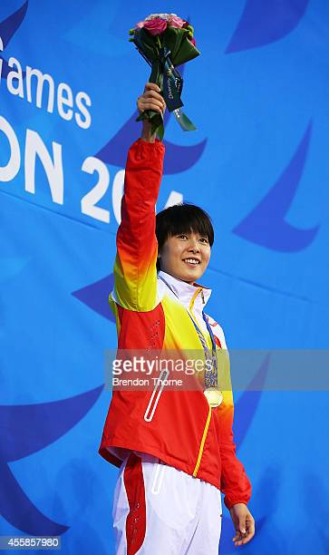 Gold medalist Zhang Yuhan of China celebrates atop the podium after the Women's 400m Freestyle Final during day two of the 2014 Asian Games at Munhak...