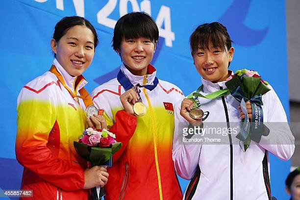 Gold medalist Zhang Yuhan of China Silver medalist Bi Yirong of China and Bronze medalist Chihiro Igarashi of Japan pose atop the podium after the...