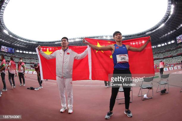 Gold medalist Zhu Dening and silver medalist Zhong Huanghao of Team China celebrate after competing in the Men's Long Jump T-38 on day 8 of the Tokyo...