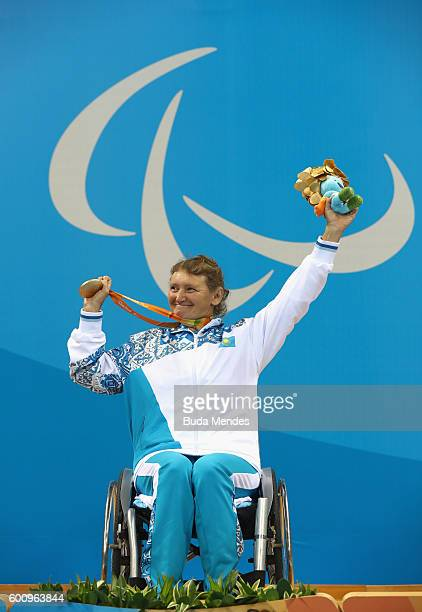 Gold medalist Zulfiya Gabidullina of Kazakhstan celebrates on the podium at the medal ceremony for the Women's 100m Freestyle - S3 on day 1 of the...