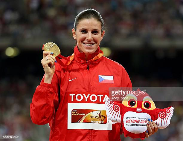 Gold medalist Zuzana Hejnova of the Czech Republic poses on the podium during the medal ceremony for the Women's 400 metres hurdles final during day...