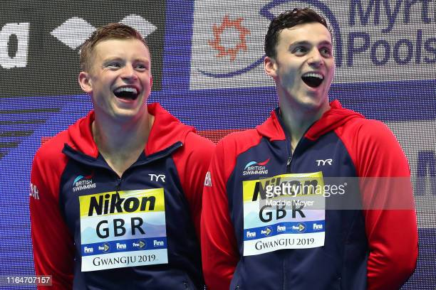 Gold medalists Adam Peaty and James Guy of Great Britain celebrate on the podium at the medal ceremony for the Men's 4x100m Medley Relay on day eight...