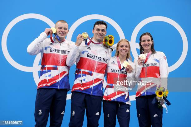 Gold medalists Adam Peaty, James Guy, Anna Hopkin and Kathleen Dawson of Team Great Britain poses during the medal ceremony for the Mixed 4 x 100m...