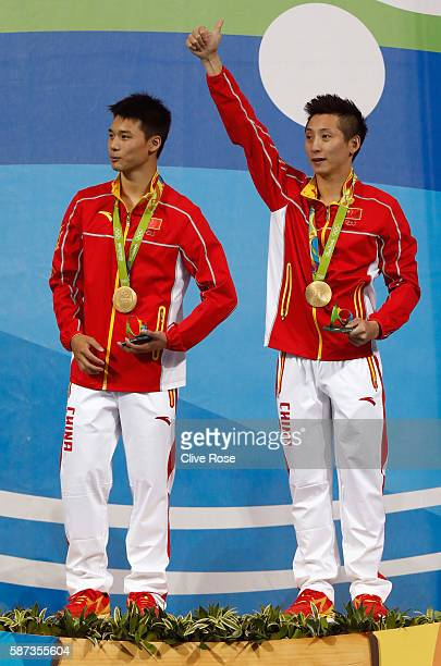 Gold medalists Aisen Chen and Yue Lin of China celebrate on the podium during the medal ceremony for the Men's Diving Synchronised 10m Platform Final...