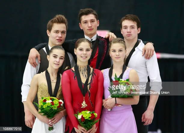 Gold medalists Aleksandr Galliamov and Anastasia Mishina of Russia are surrounded by silver medalists Apollinarlia Panfilova and Dmitry Rylov of...