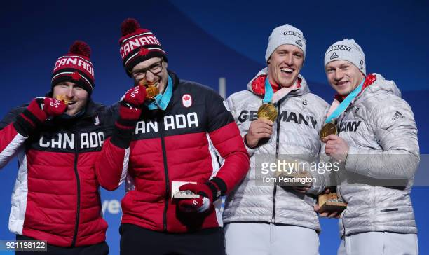 Gold medalists Alexander Kopacz and Justin Kripps of Canada and gold medalists Francesco Friedrich and Thorsten Margis of Germany celebrate during...