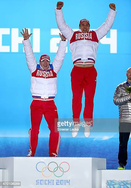 Gold medalists Alexander Zubkov and Alexey Voevoda of Russia team 1 celebrate on the podium during the medal ceremony for the Men's TwoMan Bobsleigh...