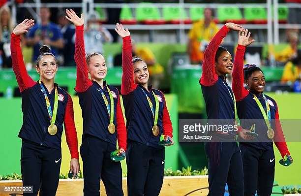 Gold medalists Alexandra Raisman Madison Kocian Lauren Hernandez Gabrielle Douglas and Simone Biles of the United States pose for photographs with...