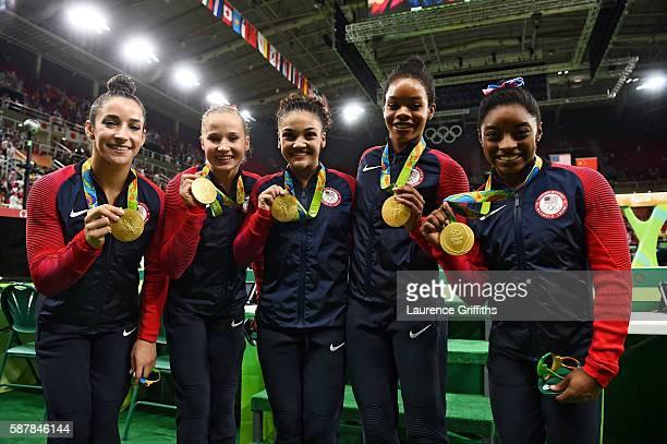 Gold medalists Alexandra Raisman Madison Kocian Lauren Hernandez Gabrielle Douglas and Simone Biles of the United States pose for photographs with...