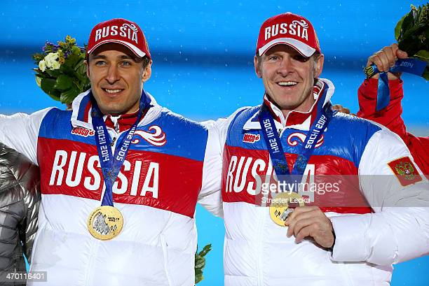 Gold medalists Alexey Voevoda and Alexander Zubkov of Russia team 1 celebrate on the podium during the medal ceremony for the Men's TwoMan Bobsleigh...