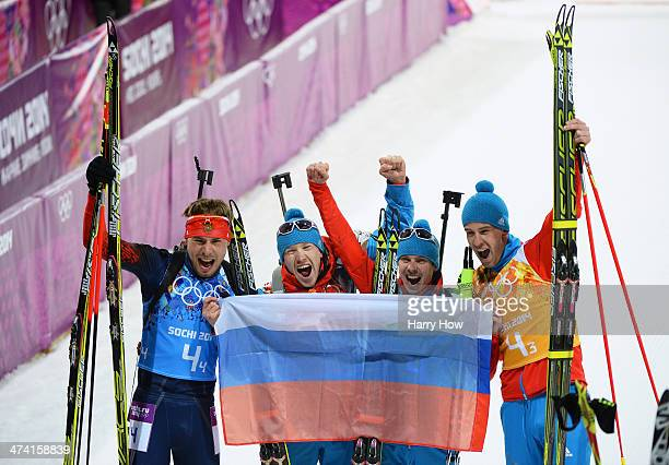 Gold medalists Alexey Volkov Evgeny Ustyugov Dmitry Malyshko and Anton Shipulin of Russia celebrate after the Men's 4 x 75 km Relay during day 15 of...