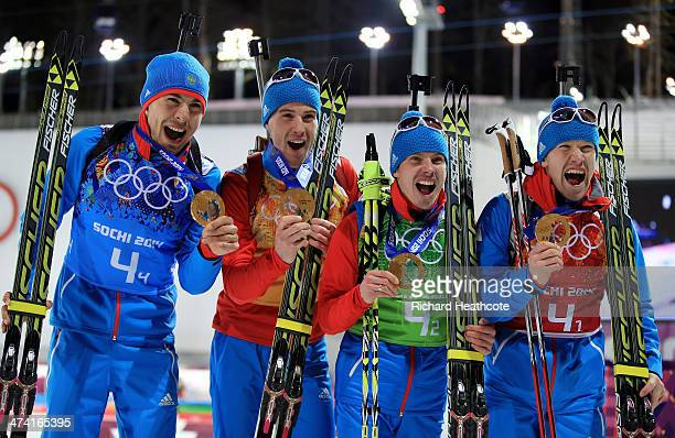 Gold medalists Alexey Volkov Evgeny Ustyugov Dmitry Malyshko and Anton Shipulin of Russia celebrate after the medal ceremony for the Men's 4 x 75 km...