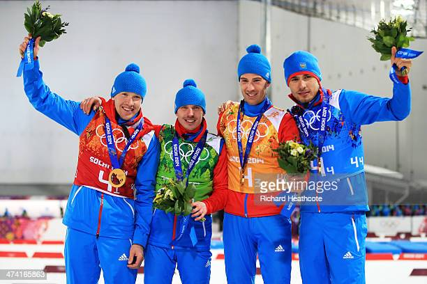 Gold medalists Alexey Volkov Evgeny Ustyugov Dmitry Malyshko and Anton Shipulin of Russia celebrate on the podium during the medal ceremony for the...