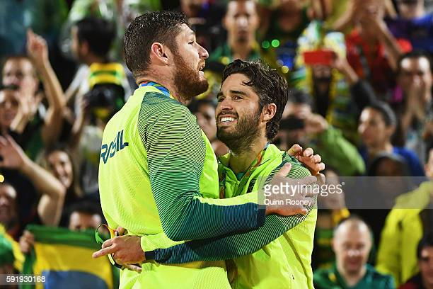 Gold medalists Alison Cerutti and Bruno Schmidt Oscar of Brazil stand on the podium during the medal ceremony for the Men's Beachvolleyball contest...