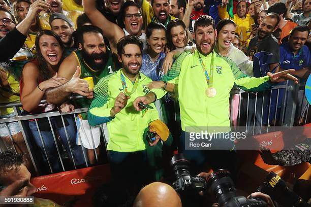 Gold medalists Alison Cerutti and Bruno Schmidt Oscar of Brazil celebrate following the medal ceremony for the Men's Beachvolleyball contest at the...