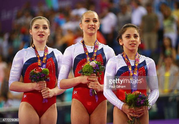 Gold medalists Aliya Mustafina Victoria Komova and Seda Tutkhalyan of Russia stand on the podium during the medal ceremony for the Women's Team Final...