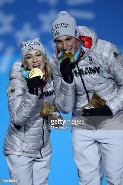 Gold medalists Aljona Savchenko and Bruno Massot of Germany celebrate during the medal ceremony for the Pair Skating Free Skating on day six of the...