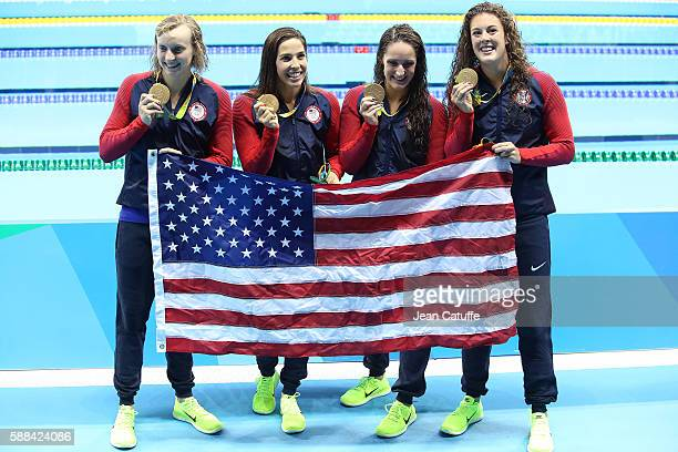 Gold medalists Allison Schmitt Leah Smith Madeline Dirado and Katie Ledecky of USA pose during the medal ceremony for the Women's 4 x 200m Freestyle...