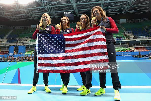 Gold medalists Allison Schmitt Leah Smith Maya Dirado and Katie Ledecky of the United States pose during the medal ceremony for the Women's 4 x 200m...