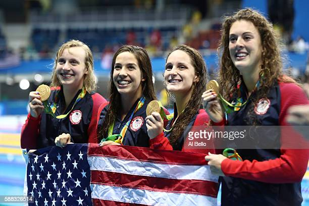 Gold medalists Allison Schmitt Leah Smith Maya Dirado and Katie Ledecky of the United States pose on the podium during the medal ceremony for the...