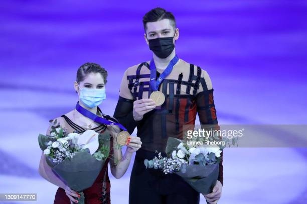 Gold medalists Anastasia Mishina and Aleksandr Galliamov of Figure Skating Federation of Russia pose for a photo during the medal ceremony for Pairs...