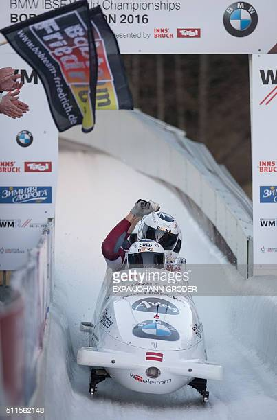 Gold medalists and World champions Oskars Melbardis Daumants Dreiskens Arvis Vilkaste Janis Strenga of Latvia react after their FourMan Bobsleigh 4th...