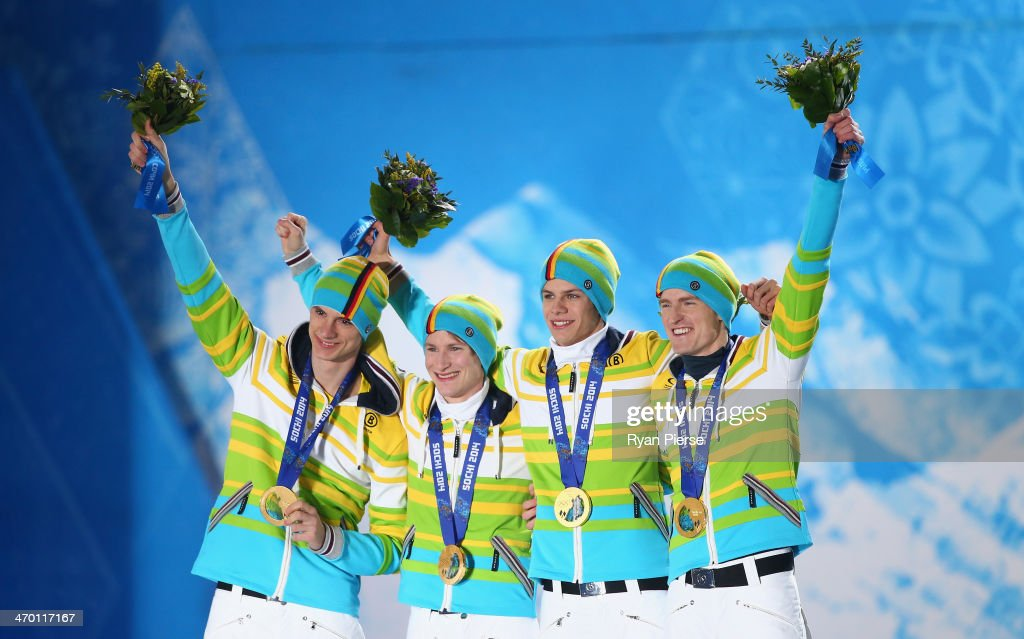 Gold medalists Andreas Wank, Marinus Kraus, Andreas Wellinger and Severin Freund of Germany celebrate during the medal ceremony for the Men's Team Ski Jumping on day 11 of the Sochi 2014 Winter Olympics at Medals Plaza on February 18, 2014 in Sochi, Russia.