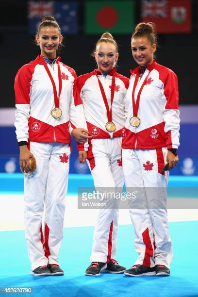 Gold medalists Annabelle Kovacs Patricia Bezzoubenko and Maria Kitkarska of Canada pose on the podium during the medal ceremony Rhythmic Gymnastics...