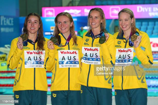 Gold medalists Ariarne Titmus Madison Wilson Brianna Throssel and Emma McKeon of Australia pose during the medal ceremony for the Women's 4x200m...