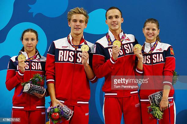 Gold medalists Arina Openysheva Daniil Pakhomov Anton Chupkov and Mariia Kameneva of Russia stand on the podium during the medal ceremony for the...
