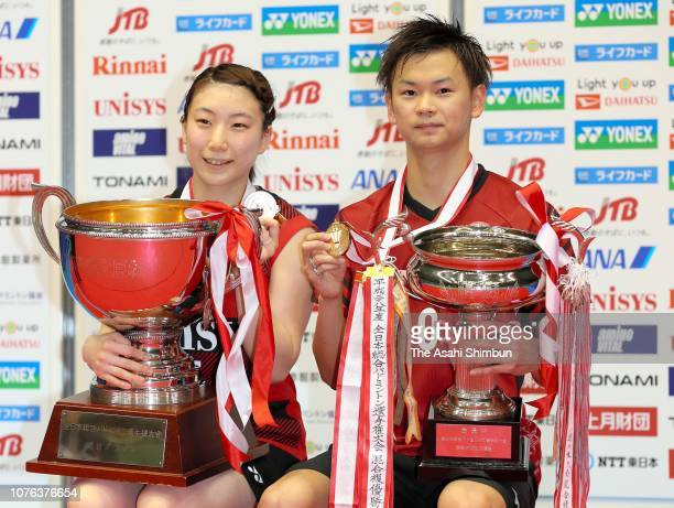 Gold medalists Arisa Higashino and Yuta Watanabe celebrate at the medal ceremony for the Mixed Doubles on day seven of the Japanese National...