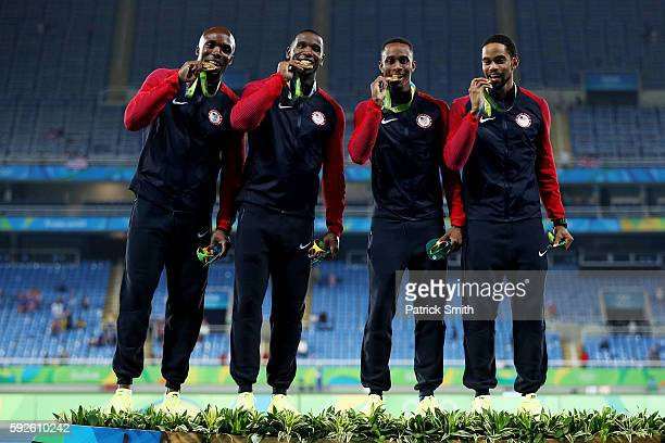 Gold medalists Arman Hall Tony McQuay Gil Roberts and Lashawn Merritt of the United States stand on the podium during the medal ceremony for the...