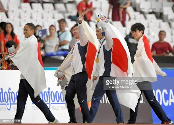 Gold medalists Aska Cambridge Yoshihide Kiryu Ryota Yamagata and Shuhei Tada of Japan celebrate after the medal ceremony for the Men's 4x100m Relay...