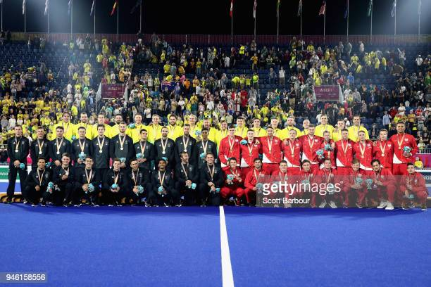 Gold medalists Australia silver medalists New Zealand and bronze medalists England celebrate on the podium during Hockey on day 10 of the Gold Coast...