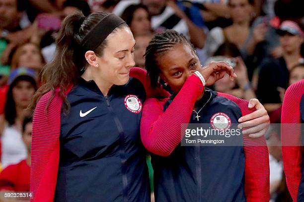 Gold medalists Breanna Stewart and Tamika Catchings of United States celebrate during the medal ceremony after the Women's Basketball competition on...