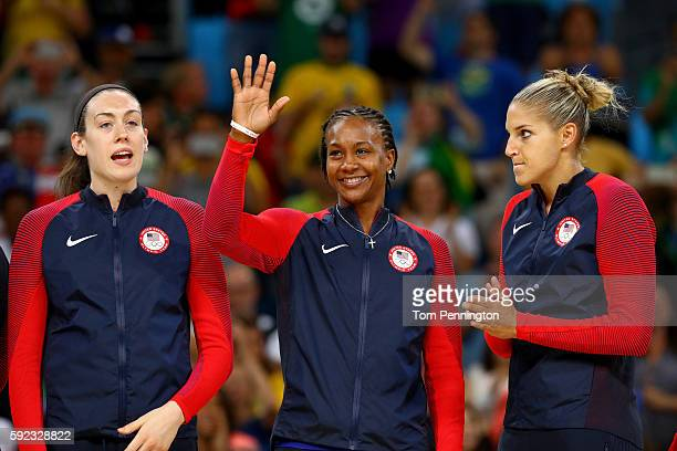 Gold medalists Breanna Stewart Tamika Catchings and Elena Delle Donne of United States celebrate during the medal ceremony after the Women's...