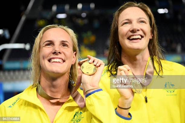 Gold medalists Bronte Campbell and Cate Campbell of Australia pose during the medal ceremony for the Women's 4 x 100m Freestyle Relay Final on day...