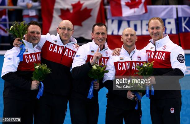 Gold medalists Caleb Flaxey Ryan Harnden EJ Harnden Ryan Fry and Brad Jacobs of Canada celebrate during the flower ceremony for the Men's Gold Medal...