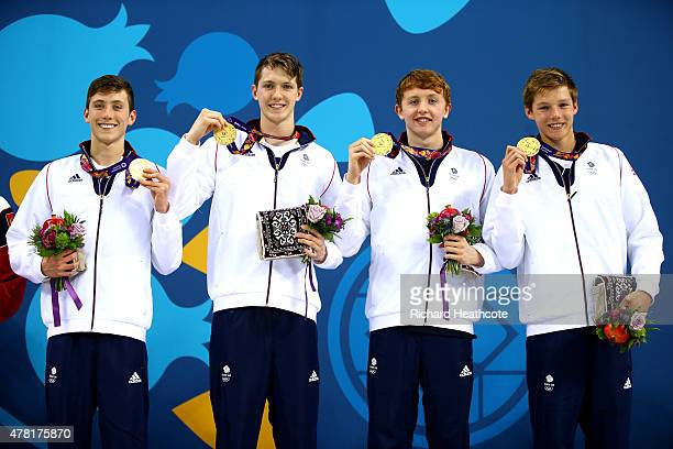 Gold medalists Cameron Kurle Daniel Speers Martyn Walton and Duncan Scott of Great Britain celebrate on the podium prior to receiving the medals won...