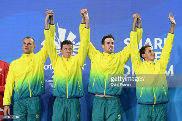 Gold medalists Cameron Mcevoy James Magnussen Jack Cartwright and Kyle Chalmers of Australia pose during the medal ceremony for the Men's 4 x 100m...