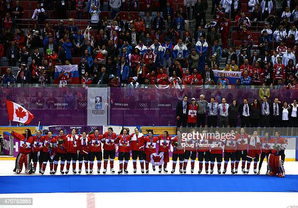 Gold medalists Canada celebrate during the flower ceremony for the Ice Hockey Women's Gold Medal Game on day 13 of the Sochi 2014 Winter Olympics at...