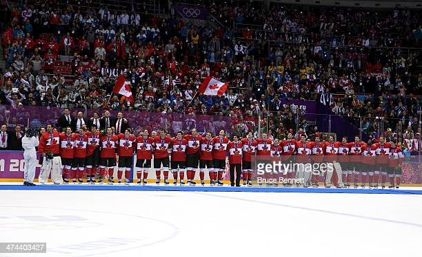 Gold medalists Canada celebrate during the medal ceremony after defeating Sweden 30 during the Men's Ice Hockey Gold Medal match on Day 16 of the...