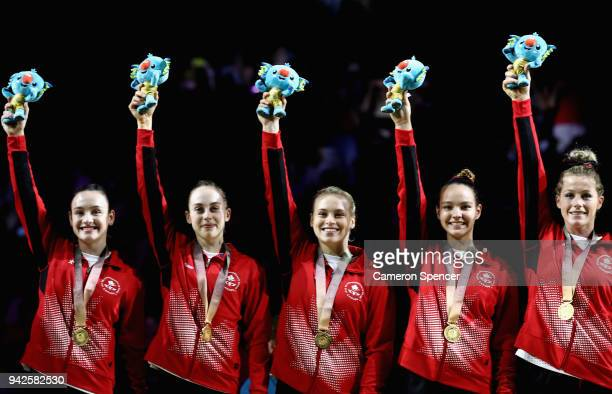 Gold medalists, Canada celebrate on the podium during the Women's Team Final and Individual Qualification Artistic Gymnastics on day two of the Gold...