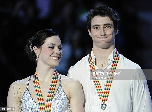 Gold medalists Canada's Tessa Virtue and Scott Moir celebrate on the podium of the Ice Dance competition at the World Figure Skating Championships on...